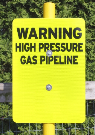 Sign warns of a high pressure gas pipeline photo