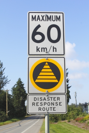 proceed: A sign displays to the public where to proceed in the event of an earthquake  Stock Photo