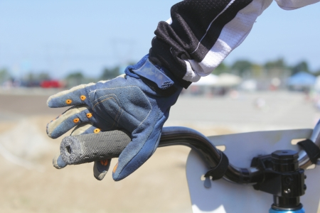 Close the hand of a BMX biker gripping his handlebar Stock Photo - 14813908
