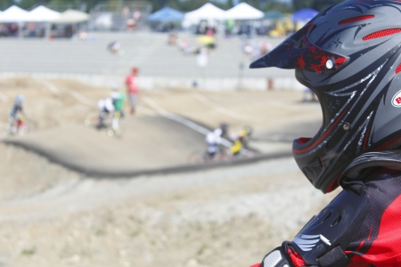 A child watches a BMX competition in Abbotsford, British Columbia on August 11, 2012.