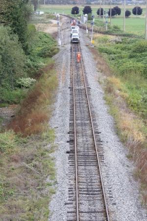 High angle view of a crew maintaining a railway track 版權商用圖片