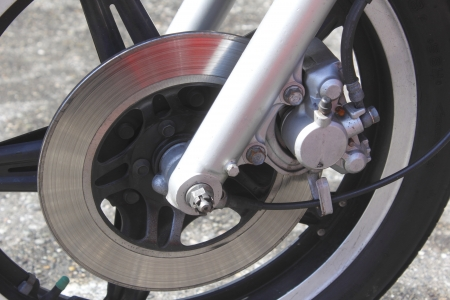 padding: A motorcycles front disc brake Stock Photo