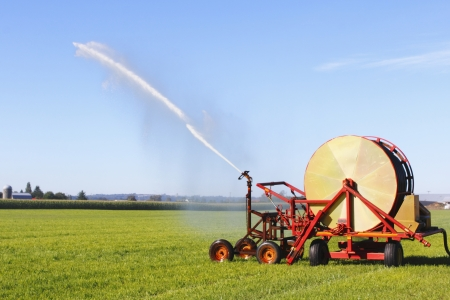 machines: Machines irrigates a field used for grazing land.  Stock Photo