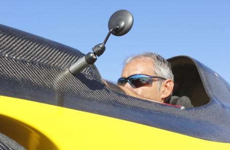 medium shot: Medium shot of man in Bicycle car cockpit
