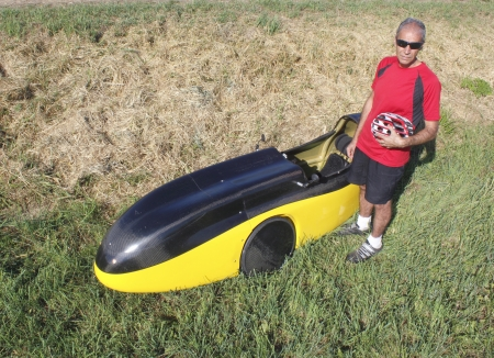 High angle view of man standing beside his recumbent Velomobile or Bicycle Car Stock Photo - 15336212