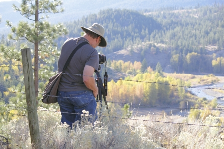 snaps: A tourist snaps a picture of the Cascade Mountain Range in southern British Columbia