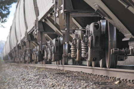 Train wheels roll down the track