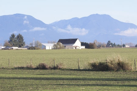 mountainscape: Farms craddled amoung mountains Stock Photo