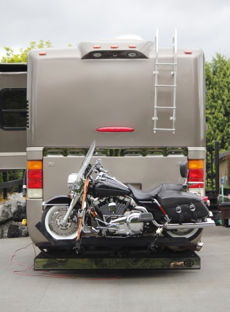 hitched: A motorcycle is hitched onto a recreational vehicle