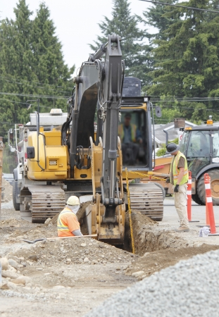 culvert: Crews dig a culvert for a new sewer system in a mid-size city