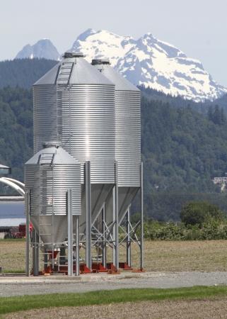 Feed silos or bins on a valley farm   photo