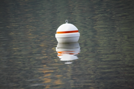 bounds: A white buoy marks an out of bounds area  Stock Photo