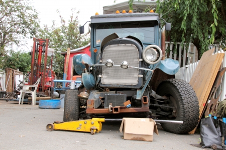 jalopy: Front view of an old jalopy in the midst of being restored