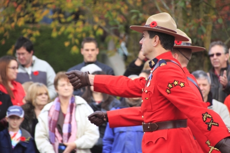 honouring: Members of the Royal Canadian Mounted Police march in procession during Remembrance Day ceremonies