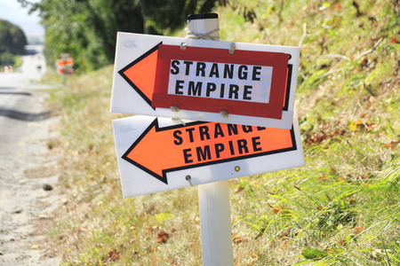 Arrows point to an on location shooting set for STRANGE EMPIRE, a Western tv series whose heroes are women.
