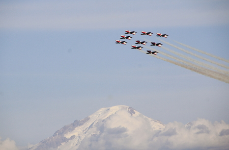 A team of the Canadian Snowbirds fly in formation over Washington