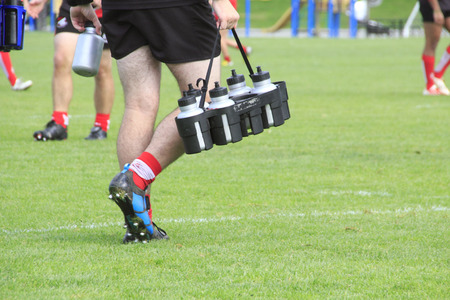 Water bottles are carried out for Rugby players.