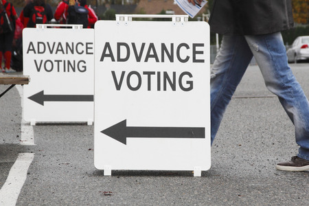 polling station: A voter is on his way to cast a ballot at a local advanced polling station. Stock Photo
