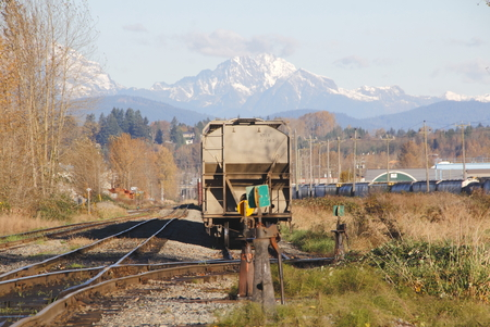 snow capped: A railway yard at the foot of snow capped mountains.