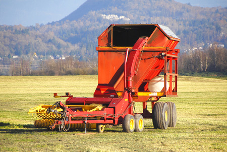 machinery: Farm machinery used for making hay bales.