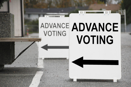 voting: Signs near a station point the way for people during early voting