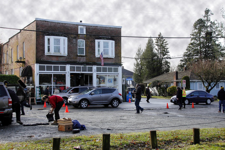 hallmark: Crew from the Hallmark production of Garage Sale Mystery Part Two set up equipment in front of a historic storefront in Clayburn, BC on December 7th, 2014.