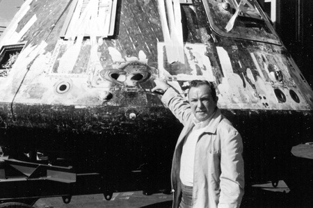 A man on the USS Hornet stands beside the Apollo 11 space capsule shortly after it returned from the moon. Editorial