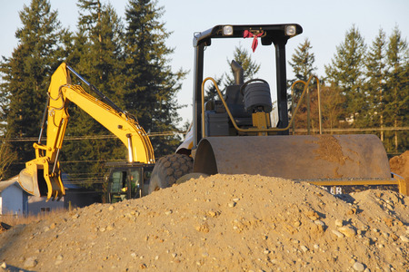Heavy industrial equipment used to move soil and earth.