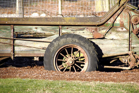 machinery: Frontal view of a turn of the century spoked wheel or tire used for farm machinery.