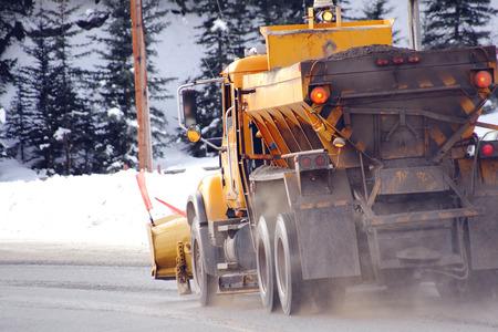 An industrial snowplow clears a rural road. photo