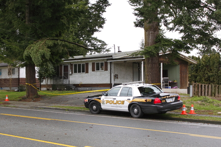 cordoned: An area is cordoned off by police where a branch has fallen onto a power line in Abbotsford, BC on January 14, 2015. Editorial