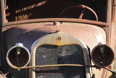 rusting: An old, rusting antique car from the 1920s Stock Photo