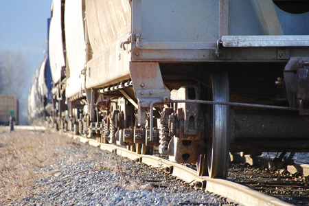 axle: A low angle detailed look at a train axle and wheels Stock Photo