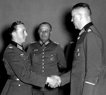 attempted: General Friedrich Olbricht (center), co-conspirator to assasinate Hitler in 1944, watches as a soldier is honored for bravery on October 9, 1941 in Berlin, Germany.