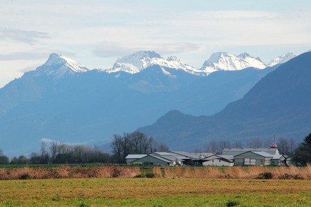 Three snow capped peaks represent the Cheam mountain range in south west British Columbia, Canada.