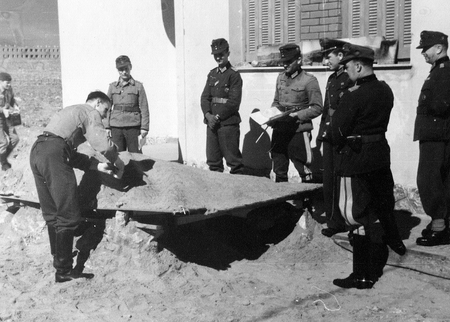 wehrmacht: German Generals watch as a technician builds an outdoor set that will be used by General Ringel to explain tactics used on the Greek Island of Crete in the Spring of 1941.