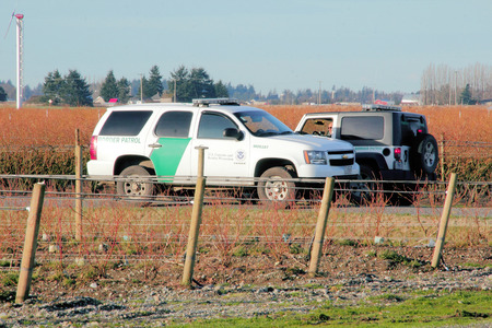 smuggling: Two American border patrol vehicles meet near the Canadian and American border crossing in Washington State.