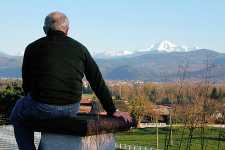 A middle aged man enjoys the view of Washingtons Mount Baker