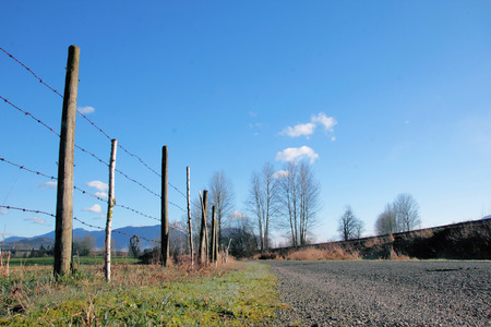 low  angle: Low angle view of a gravel country road. Stock Photo