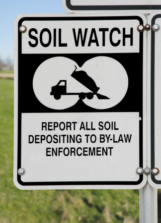 dumping: A sign asks local residence to report illegal soil dumping.