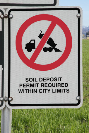 be alert: A sign informs people that a permit is required for dumping material within city limits.