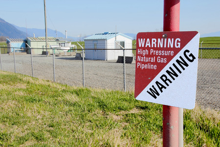 A sign warns that a high pressure gas pipeline is close to a metering station. photo