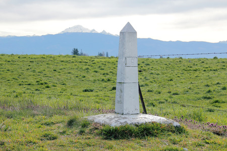 mount baker: A marker displaying the American and Canadian border crossing in western Washington State.