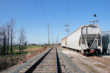 runoff: A side track or run-off provides parking or storage facilities for railway cars. Stock Photo
