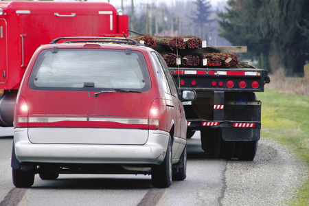 sudden: A large semi trailer makes a sudden turn forcing a driver to slam on the brakes.