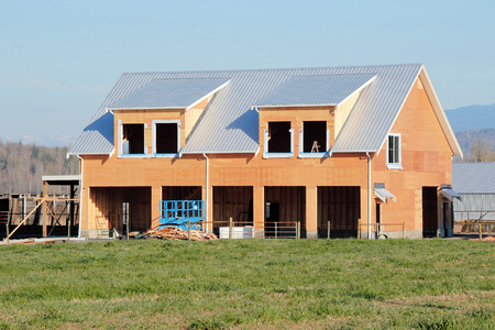 durable: A durable and long lasting metal roof is installed on a newly constructed building.