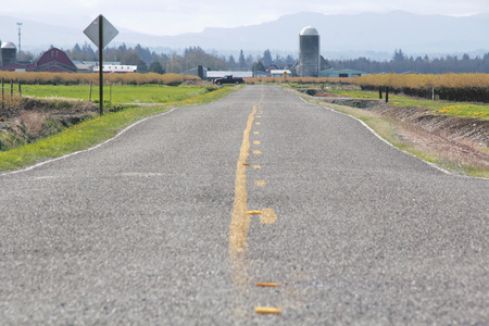 paved: A straight two lane paved road in rural Washington State.