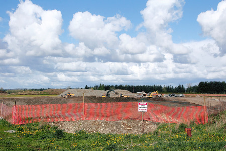 stay alert: An open gravel pit in a rural area.