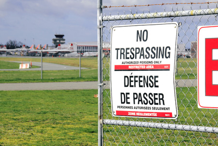 do not enter: A sign warns of trespassing in a secure area of an airport.
