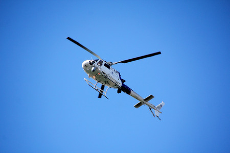 border patrol: Washington State border patrol helicopter patrolling the Canadian and Washington border. Editorial